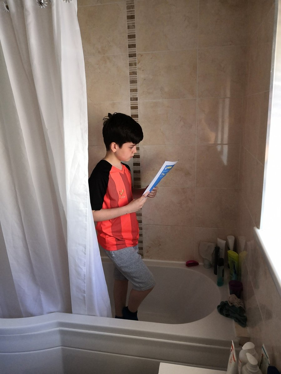 #Get Caught Reading Task - reading in the shower.