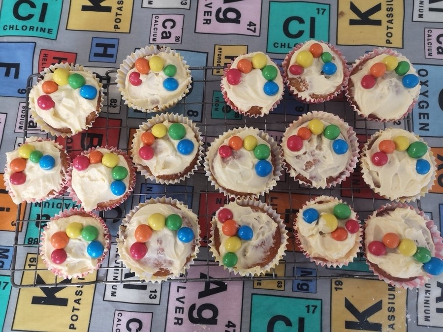 Emily & Jake T made cakes decorated with smarties in rainbow colours