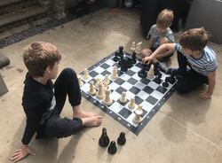 Joseph, Noah and Asher playing chess together