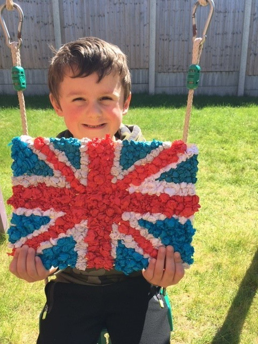 A year 1 child with his homemade flag.