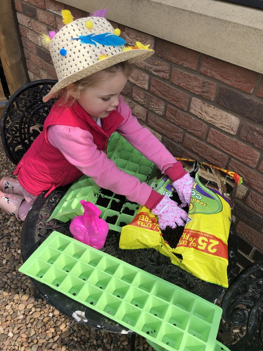 Scarlett planting while wearing her Easter hat