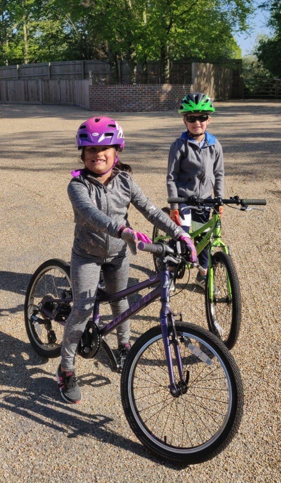 Indya and Leon taking a bike ride in the sun - Year 2