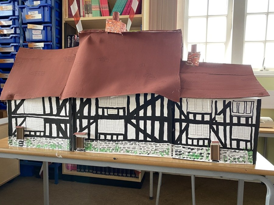 Key Worker Group topic work is about Henry VIII and Tudors .    We have built the Tudor cottages that are opposite the school .