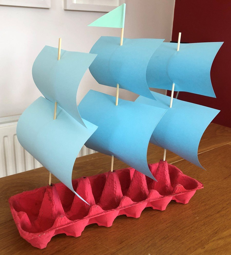 Red egg box sailing ship with three lots of sails