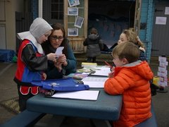EYFS writing outside with SC.JPG
