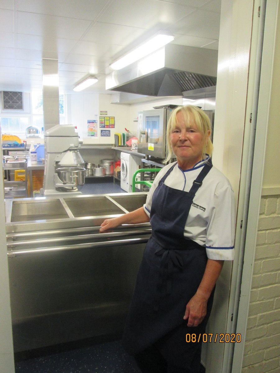 This is Jane. She is our school cook. She will serve you your dinner.