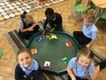 Matha, Ellie- Jean, Charlie, Henry and Emily sorting mini beasts into colours.jpg