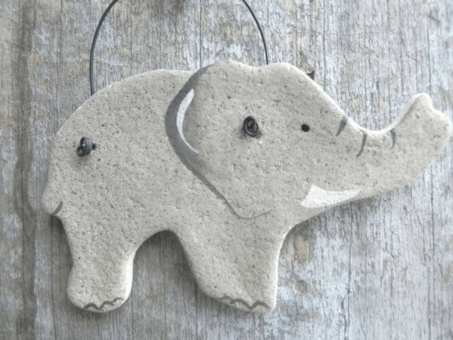 Make some elephant shapes with salt or playdough. You could make them flat or even try to make them stand up.