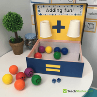 Make an addition machine using a shoebox and 2 paper cups. Add an amount tothe first cup and an amount to the secondcup. what is the total amount in the box?