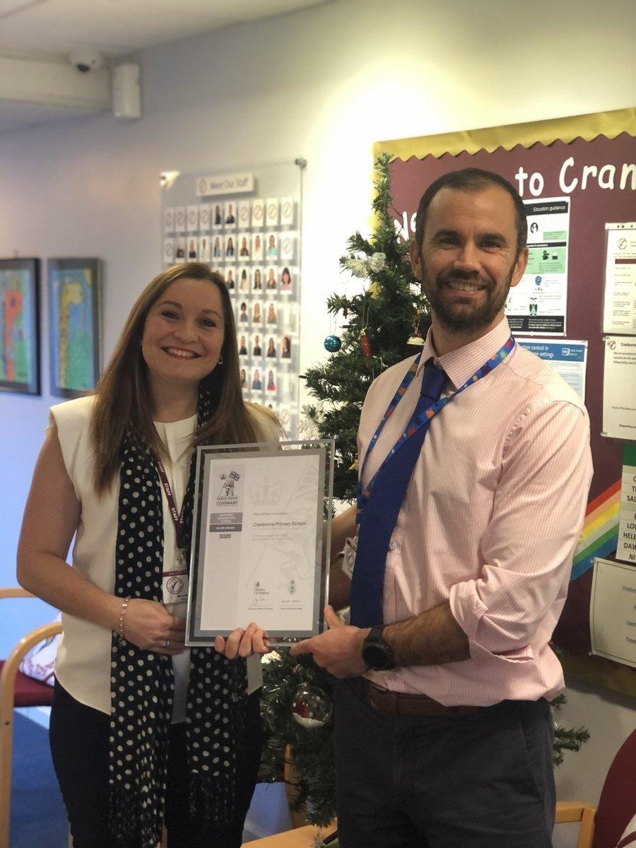 Mrs Keilty and Mr Balchin with Cranborne's Silver Award :-)