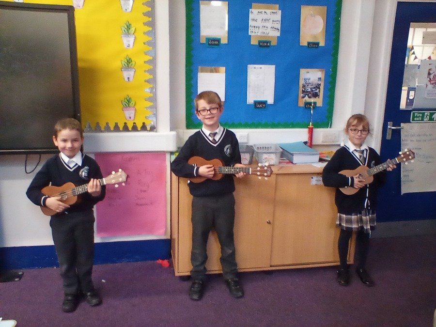 Some children in Class 7 playing the Ukele in Jack's Music lesson!
