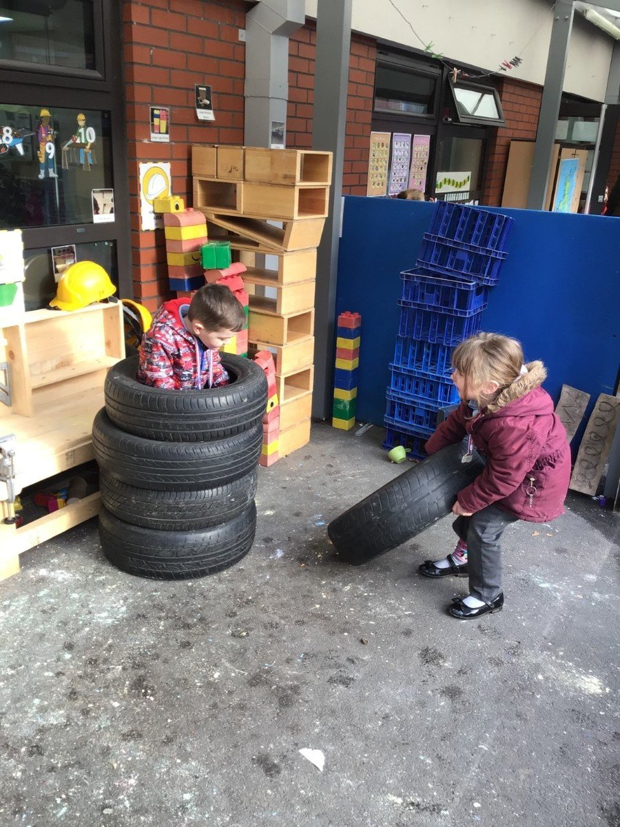Tyres can be used together to create climbing, balance and coordination challenges for little bodies; or in this case just hiding from teachers!