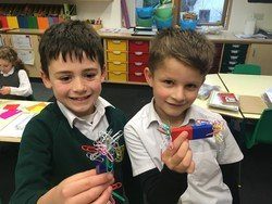 Riley and Patrick experiment with magnets