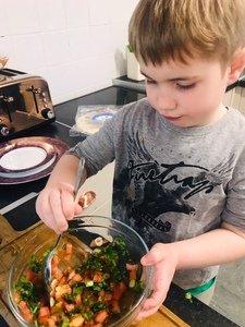 Jacob making salsa