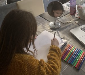 Amelia busy drawing her self-portait
