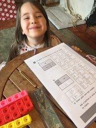 Christa doing her maths work