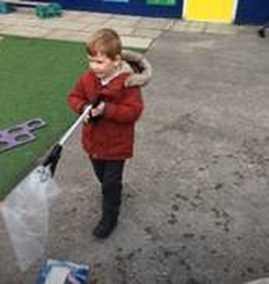 Early Years look at litter picking and discuss how to respect our environment.