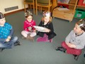 Nursery children playing pass the parcel.