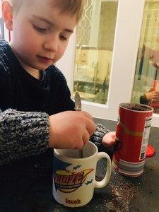 Jacob mixing his hot cocoa