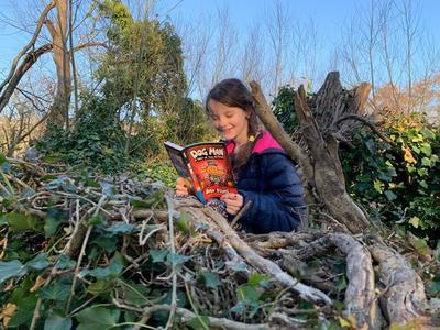 Emily caught reading outside