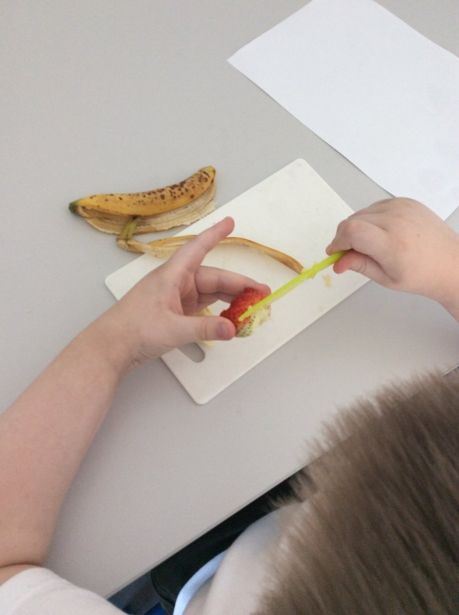 C- Year group 2, Pathway 2 Practising skills of peeling and chopping soft fruits with a knife on a chopping board. Wonderful work!