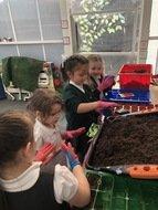 Girls planting.jpg