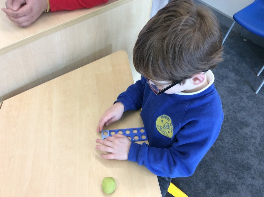 V used the numicon to work out 10+2. Amazing maths skills!