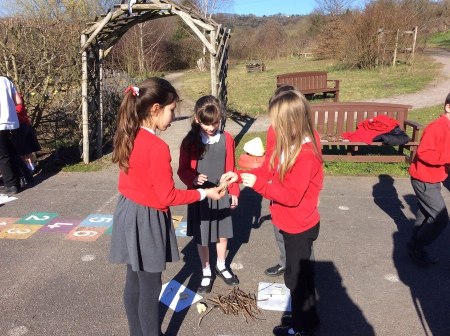 Using sticks and pebbles in our Fairtrade lesson.