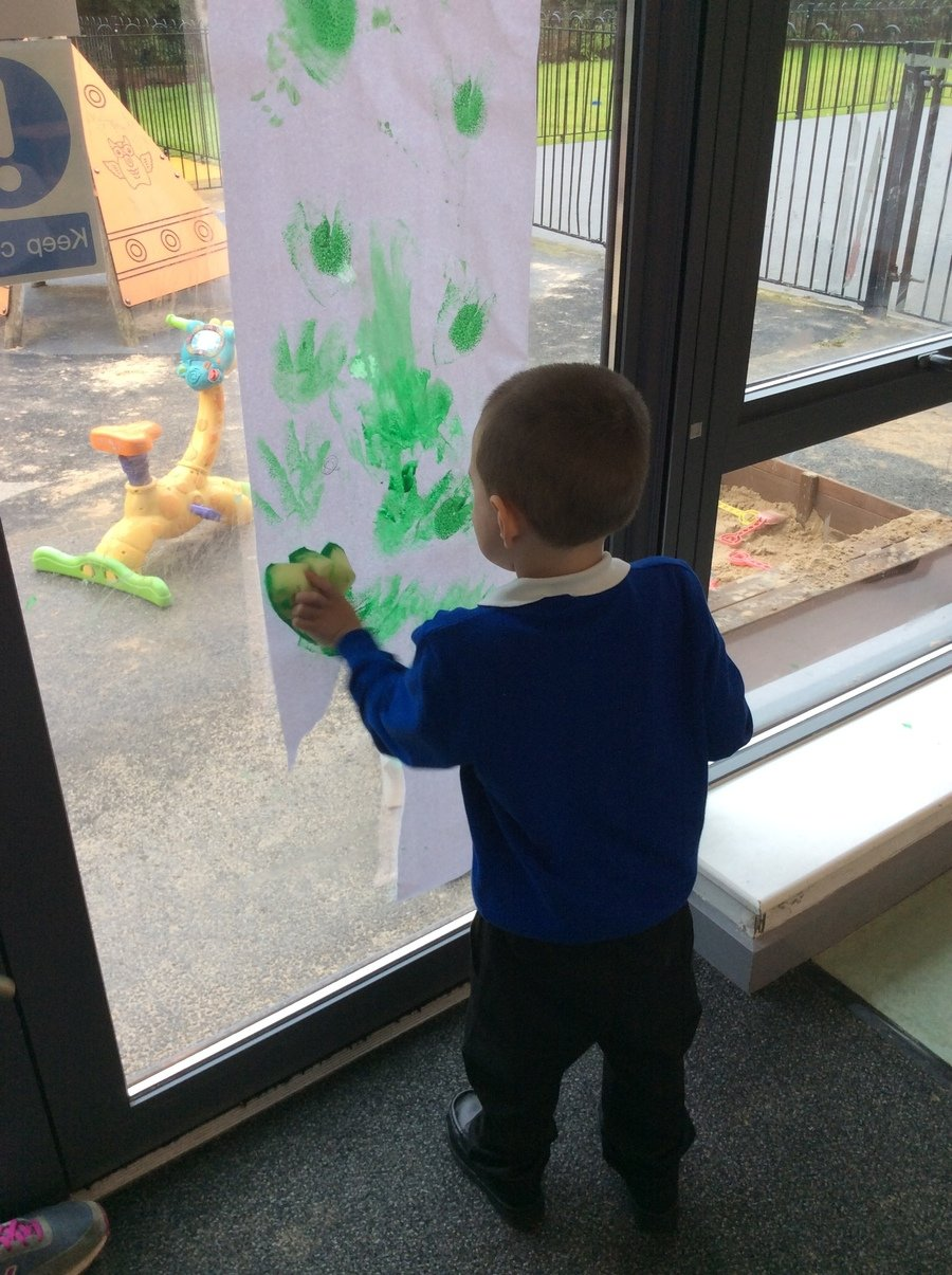 "A, Year 1, Pathway 1 made dinosaur footprints and said ""Stamp, stamp, stamp,"" as he did each footprint. He doesn't normally like getting messy so this is a fantastic achievement."