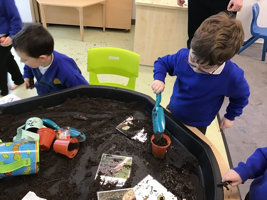 R loved our planting session. He followed simple instructions to plant some beans. He was very confident using a spade to add soil in the pot.