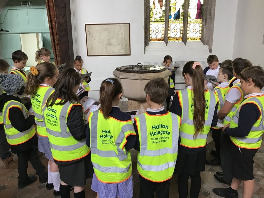 14/5/2021 Class 2 Walked to St Andrew's Church to find the font in the new children's handbook that the church have created. Class 2 have been covering Baptism in R.E. this Term