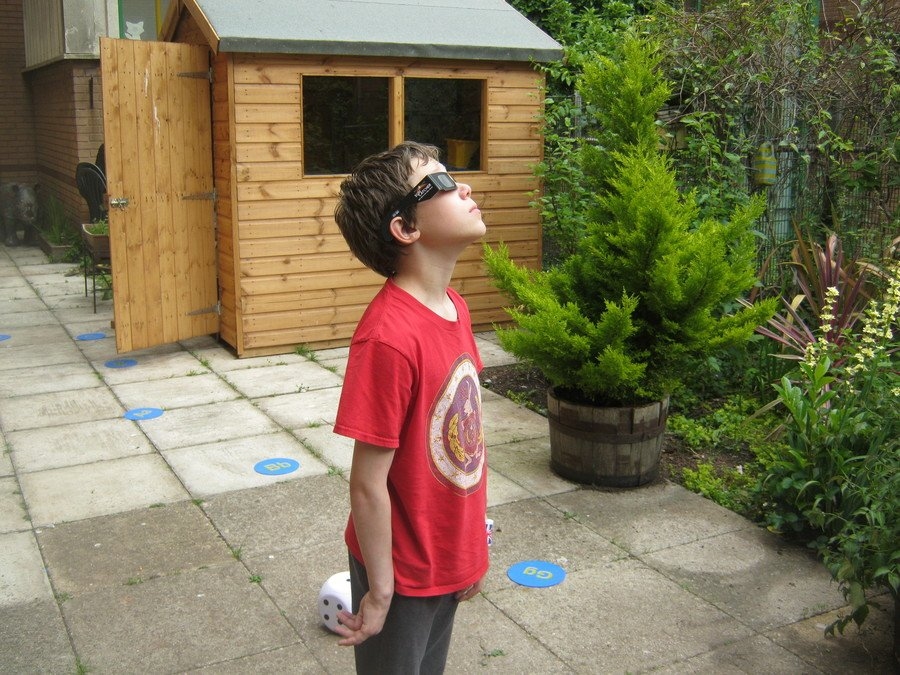 Noah observes the partial solar eclipse
