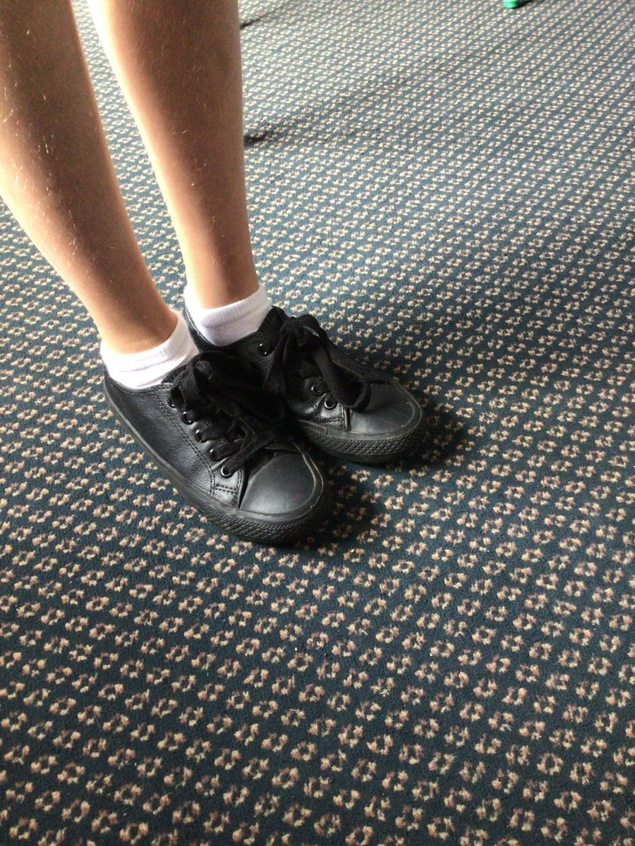 An example of the black trainer style shoe that children are  wearing