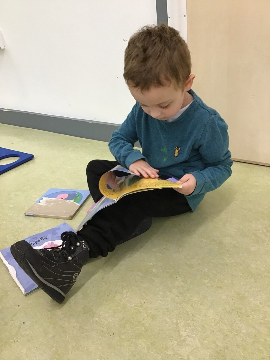 J independently turned the pages of a book he chose to read. Wonderful reading J!