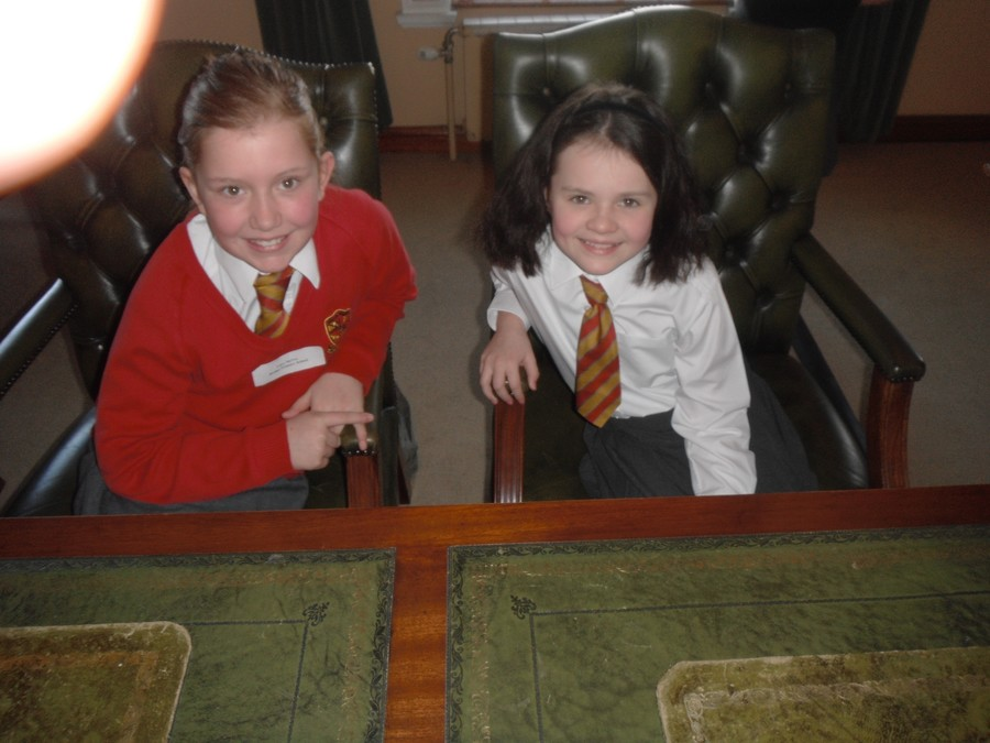 Lucy and Cara relaxing in the BDC Councillors' chairs after presenting their speeches!