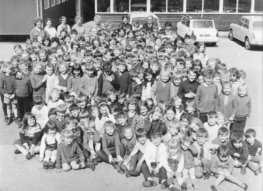 A school photograph in the early 1970s. Note the classrooms in huts. The present school principal, Mrs Felicity Humphreys (nee Scott) is in this school photograph as a pupil