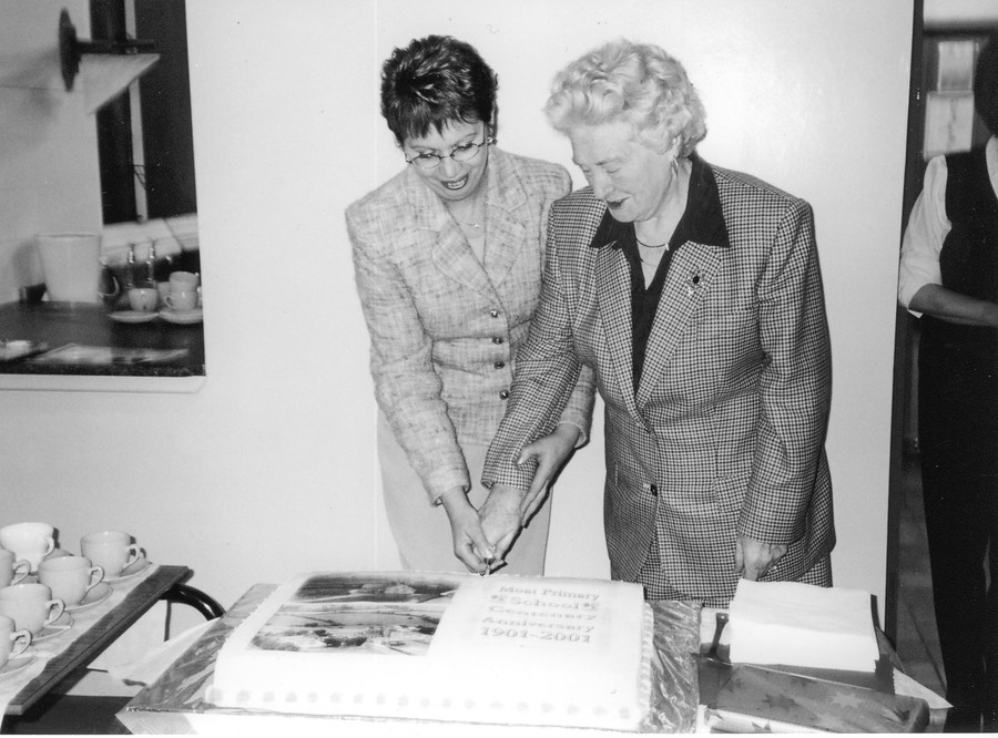2001 - Marking the Centenary with the cutting of the cake. Mrs V Clendenning, principal.