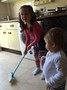 Maria helping to brush the florr