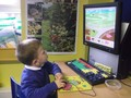 Developing skills in using the computer mouse. Selecting, clicking and dragging pictures.