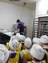 Watching the baker make rolls.JPG