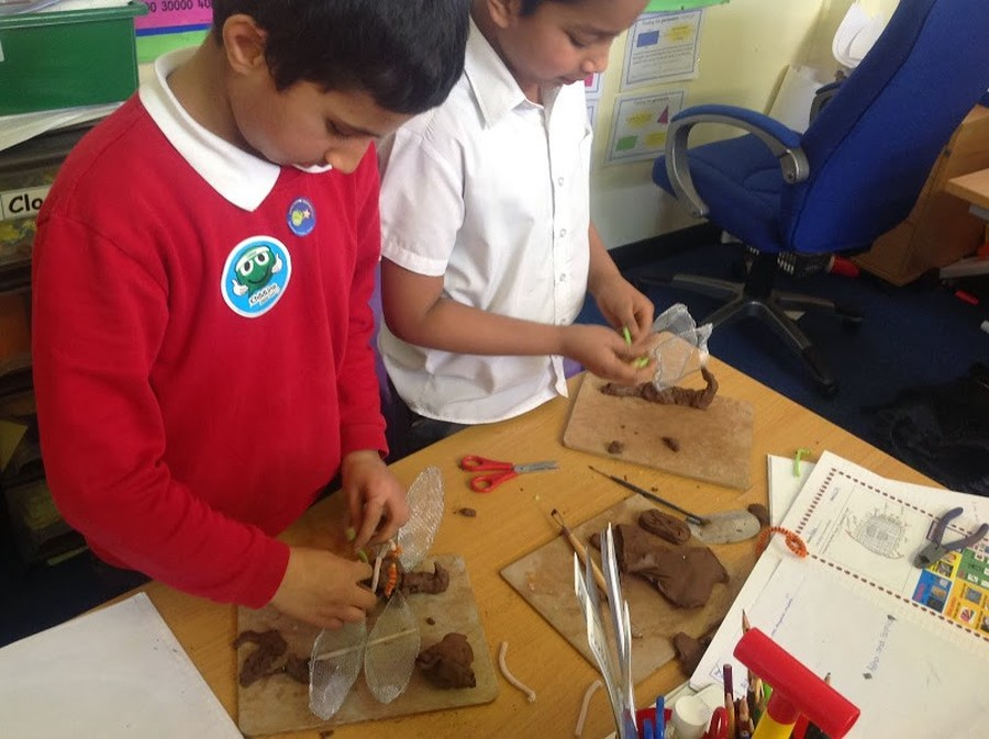 Hard at work! Children use their original design to make a minibeast model.