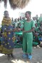 SAM_2242 Nabei one of our parents presenting uniform to  Sabthiyo a class 5 girl.JPG
