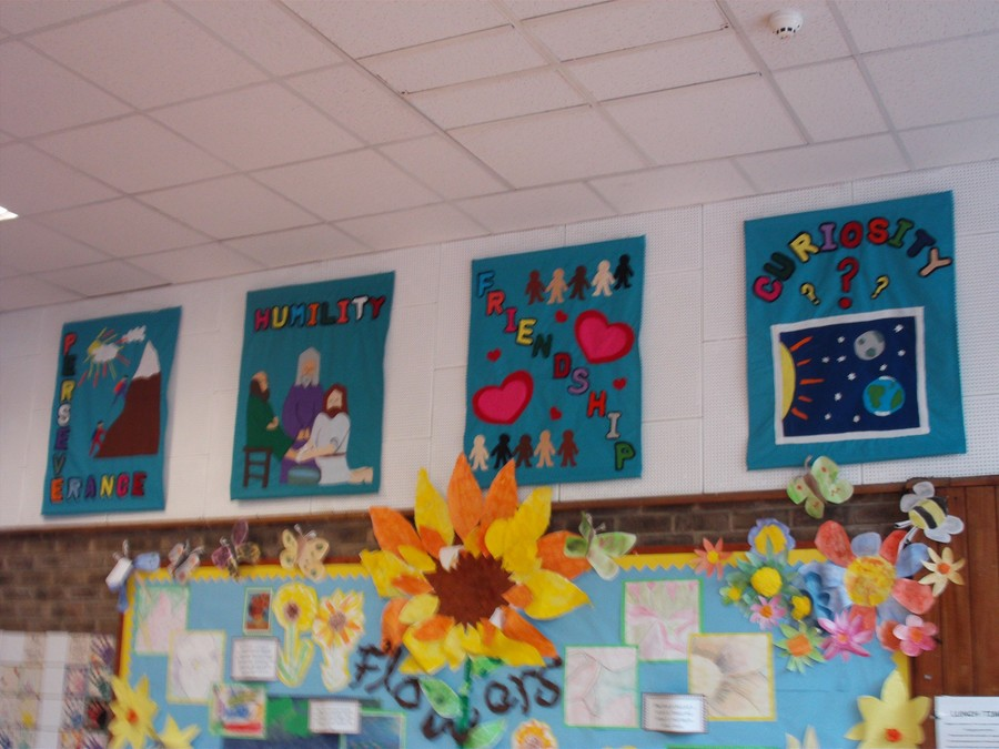 4 of the 6 Banners which show our school values