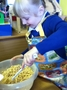 The children took it in turns to add in the ingredients