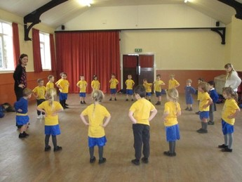 Warming up for our PE lesson at the Village Hall.