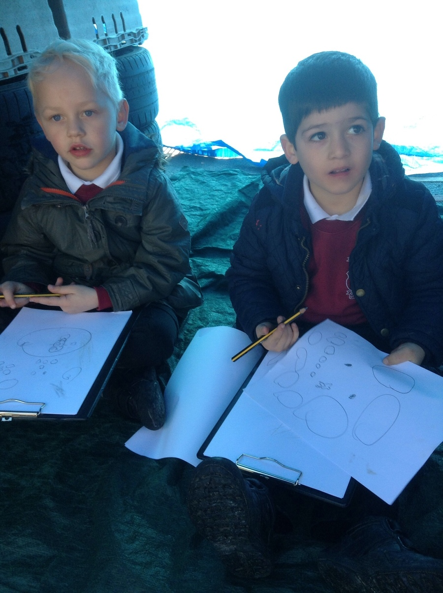 "Louie and Benjamin took paper and pencils into their den to design ""booby traps"" !"