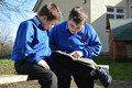 Boys reading outside.JPG
