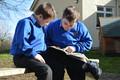 Boys reading outside.JPG