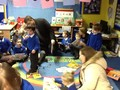 Our Mums and Dads came to our story café, reading us stories on the carpet.