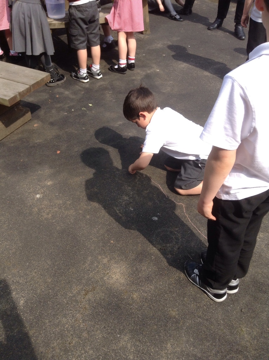 carefully drawing around our partners shadow.